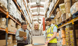 Warehouse team working together on laptop Stock Photography