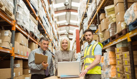 Warehouse team working together on laptop Stock Photos
