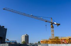 Warehouse tower cranes and construction equipment royalty free stock photo