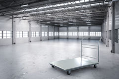 Warehouse trolley in factory Royalty Free Stock Photos