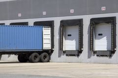 Warehouse truck loading. Truck unloading or receiving at Warehouse Loading dock bay Royalty Free Stock Images