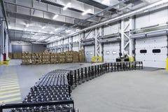 Warehouse. Unloading with conveyor belt Royalty Free Stock Photo