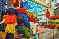 Skeins of yarn in waehouse of Vakil Bazaar, Shiraz, Iran. The warehouse in Vakil Bazaar with large amount of colored woolen skeins of yarn for carpets and rugs royalty free stock images