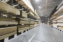Warehouse with variety of timber for construction Stock Image