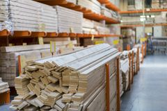 Warehouse with variety of timber for construction and repair. Delivery concept. royalty free stock image