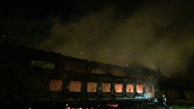 Warehouse and wagon in flames stock footage