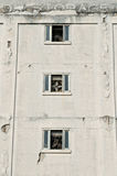 Warehouse Windows with Fans Royalty Free Stock Images