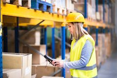 Warehouse woman worker with barcode scanner. Warehouse woman worker or supervisor with barcode scanner. A mobile handheld PC with barcode scanner Royalty Free Stock Photo