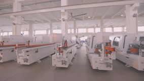 Warehouse woodworking machines, New woodworking machines stand in a row in stock.  stock video footage