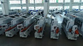 Warehouse woodworking machines, New woodworking machines stand in a row in stock.  stock video