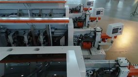 Warehouse woodworking machines, New woodworking machines stand in a row in stock.  stock footage