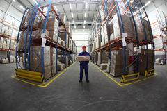 Warehouse worker with box Stock Photography