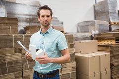 Warehouse worker carrying a small box Royalty Free Stock Photos