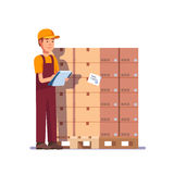 Warehouse worker checking goods on pallet Royalty Free Stock Images