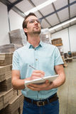 Warehouse worker checking his list on clipboard Royalty Free Stock Photos