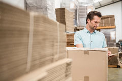 Warehouse worker checking his list on clipboard Stock Photo