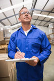 Warehouse worker checking his list on clipboard Royalty Free Stock Photography