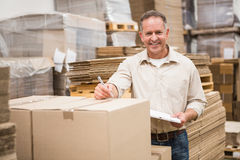 Warehouse worker checking his list on clipboard Stock Photos