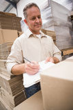 Warehouse worker checking his list on clipboard Royalty Free Stock Photo