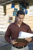 Warehouse Worker Checking His Reports Royalty Free Stock Photos