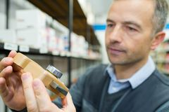 Warehouse worker checking lock royalty free stock image