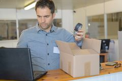 Warehouse worker checking shipping. Man Stock Images