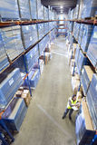 Warehouse worker with clipboard checking inventory Stock Photo