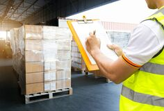 Free Warehouse Worker Courier Hand Holding Clipboard Inspecting Load Shipment Goods Stock Image - 181794231