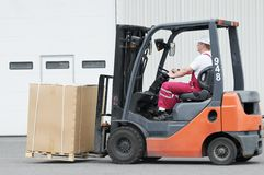 Warehouse worker driver in forklift Stock Photography