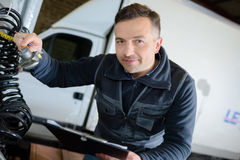 Warehouse worker driver in uniform in front delivery truck royalty free stock photo
