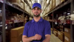 Warehouse worker folded hands in warehouse stock footage