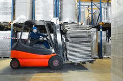Warehouse worker and forklift Royalty Free Stock Photo