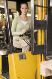 Warehouse worker in forklift Royalty Free Stock Images