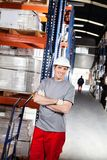 Warehouse Worker With Handtruck At Warehouse Royalty Free Stock Photos