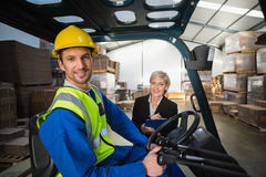 Warehouse worker and his manager smiling at camera Stock Images