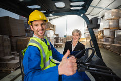 Warehouse worker and his manager smiling at camera Stock Photos