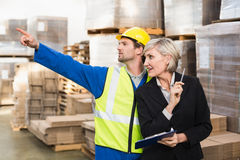 Warehouse worker and his manager working together Royalty Free Stock Photos