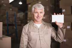 Warehouse worker holding blank paper. Portrait of warehouse worker holding blank paper in warehouse Stock Image
