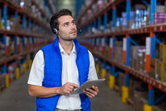 Warehouse worker holding digital tablet Stock Image