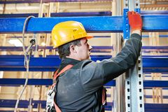 Warehouse worker installing rack arrangement Royalty Free Stock Photos