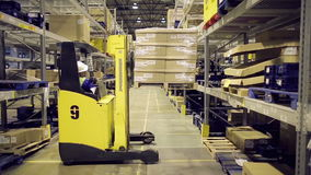 Warehouse worker loading cargo on rack stock video