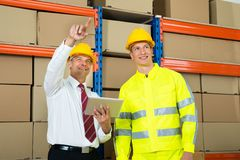 Warehouse Worker And Manager Checking The Inventory Stock Photos