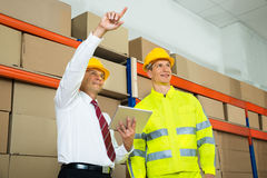 Warehouse Worker And Manager Checking The Inventory Stock Image