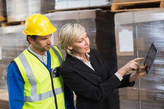 Warehouse worker and manager using tablet pc Stock Image