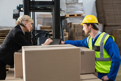 Warehouse worker and manager using tablet pc Royalty Free Stock Photography