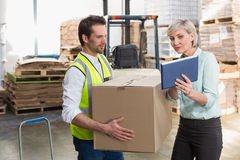 Warehouse worker and manager using tablet pc Stock Images