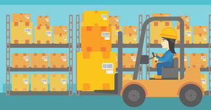 Warehouse worker moving load by forklift truck. An asian warehouse worker loading cardboard boxes. Forklift driver at work in storehouse. Warehouse worker Royalty Free Stock Photo