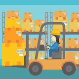Warehouse worker moving load by forklift truck. An asian warehouse worker loading cardboard boxes. Forklift driver at work in storehouse. Warehouse worker Royalty Free Stock Photography
