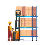 Warehouse worker operating electric fork lifter Stock Photography