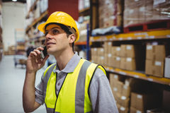 Warehouse worker on a phone call Stock Photography